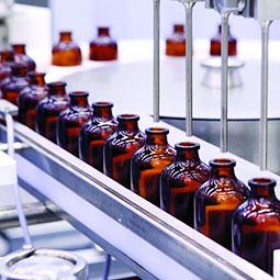 Medicine bottles being filled