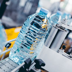 Plastic bottle of water on conveyer belt