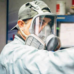 Technician using respirator