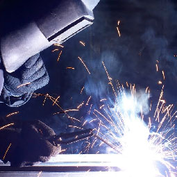 Welder working on metal